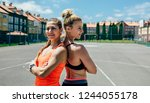 two young sportswomen posing... | Shutterstock . vector #1244055178