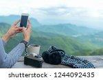 traveler woman using smartphone ...   Shutterstock . vector #1244092435