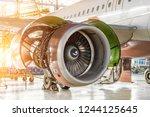 opened hood aircraft engine jet ... | Shutterstock . vector #1244125645