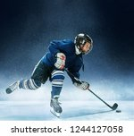 little boy playing ice hockey... | Shutterstock . vector #1244127058