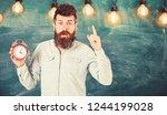 teacher in eyeglasses holds... | Shutterstock . vector #1244199028
