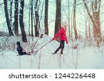 teenage girl pulling sled with... | Shutterstock . vector #1244226448