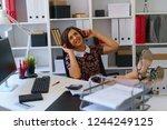 young pretty woman listen music ... | Shutterstock . vector #1244249125