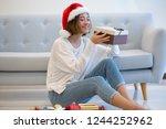 joyful christmas girl studying... | Shutterstock . vector #1244252962