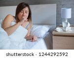 young woman coughing covered by ... | Shutterstock . vector #1244292592