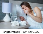 young woman coughing covered by ... | Shutterstock . vector #1244292622