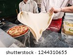 cooking pizza in the pizzeria.... | Shutterstock . vector #1244310655