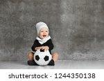 Little Boy Having Fun  Holds A...