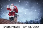 santa claus greeting on roof  | Shutterstock . vector #1244379055