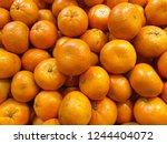 orange fruit background | Shutterstock . vector #1244404072
