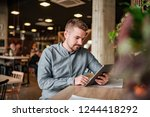young entrepreneur working on... | Shutterstock . vector #1244418292