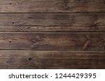 old dark wooden background | Shutterstock . vector #1244429395