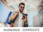 man in shopping. smiling man... | Shutterstock . vector #1244431372