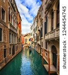 canal with gondolas in venice ... | Shutterstock . vector #1244454745