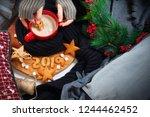 female hand holds 8 from... | Shutterstock . vector #1244462452
