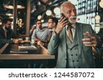 senior businessman using phone... | Shutterstock . vector #1244587072
