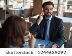 business lunch in friendly... | Shutterstock . vector #1244639092