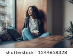 calm relaxed young woman...   Shutterstock . vector #1244658328
