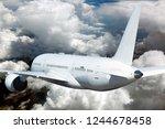 white passenger plane in flight.... | Shutterstock . vector #1244678458