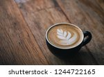 cup of coffee latte with... | Shutterstock . vector #1244722165