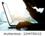 Small photo of A man sitting down, his face unsettled. At the computer desk He has headaches and stress. Cause of hard work and insufficient rest.