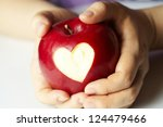 Woman's Hand With Apple  Which...