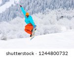 snowboarder is jumping in the...   Shutterstock . vector #1244800732