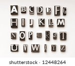 Alphabet photographed using a mix of vintage letterpress characters. Cross-processed for a vintage look. - stock photo