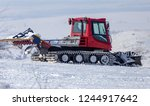Tractor On A Ski Slope In The...
