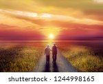 Silhouette Of Elderly Couple...