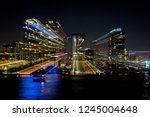 motion blur of city at night... | Shutterstock . vector #1245004648