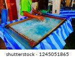 traditional way of making paper ... | Shutterstock . vector #1245051865