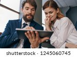 business man and woman watching ... | Shutterstock . vector #1245060745