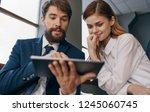 business man and woman watching ... | Shutterstock . vector #1245060745