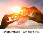 two hands of businessmen... | Shutterstock . vector #1245095248