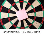 Stock photo hitting in the target center of dartboard targeting the business concept bullseye of a dartboard 1245104845