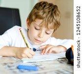 tired little kid boy at home... | Shutterstock . vector #1245108652