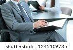 senior businessman with a... | Shutterstock . vector #1245109735