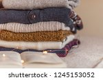 a stack of woolen sweater on... | Shutterstock . vector #1245153052