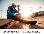senior man running  in the city.... | Shutterstock . vector #1245160552