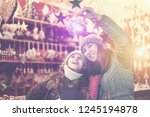 young girl and her mother are... | Shutterstock . vector #1245194878