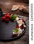 caprese appetizer with... | Shutterstock . vector #1245205555