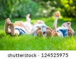 family playing on green grass... | Shutterstock . vector #124525975