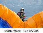 Paraglider Pilot Preparing For...