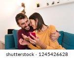beautiful young couple hugging... | Shutterstock . vector #1245426628