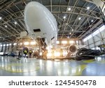 Stock photo airplane in the hangar for maintenance bottom nose view 1245450478
