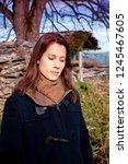 brunette young woman standing... | Shutterstock . vector #1245467605