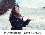 brunette young woman standing... | Shutterstock . vector #1245467608