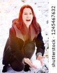 young brunette woman outdoors... | Shutterstock . vector #1245467632