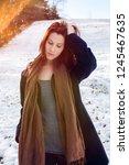 portrait of young brunette... | Shutterstock . vector #1245467635